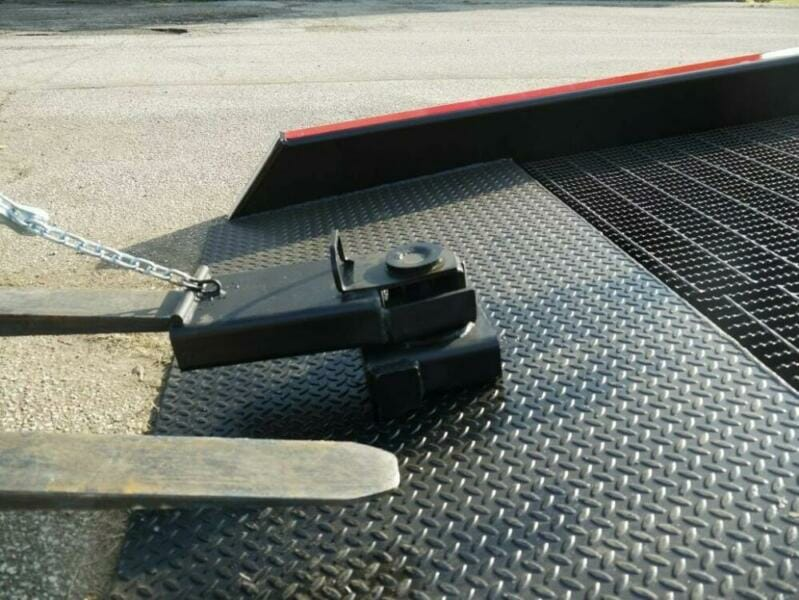 Forklift fork inserted into positioning sleeve | Heavy duty loading ramps