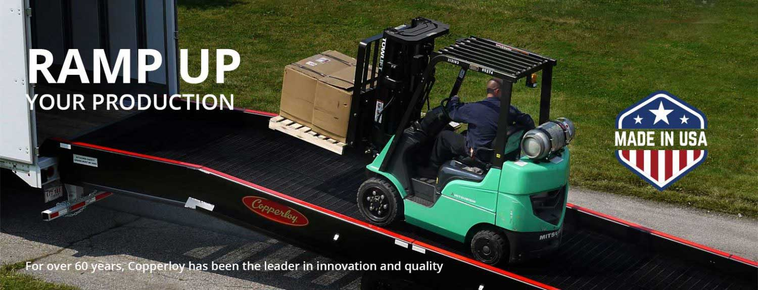 yard ramp being used with forklift loading a truck, a great example of yard ramps, used and rental loading dock ramps