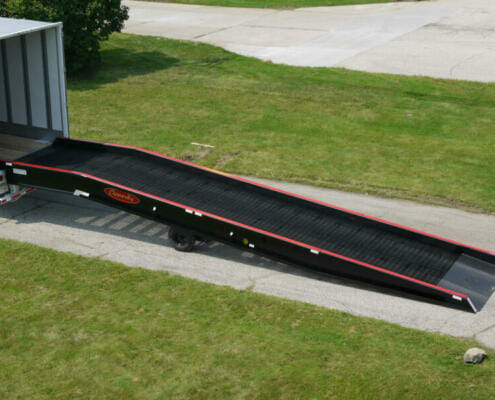 Copperloy single acting hydraulic ramp linked to a truck trailer.