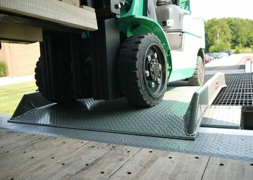 a stationary yard ramp image showing a warehouse loading dock that can be used from ground to dock height